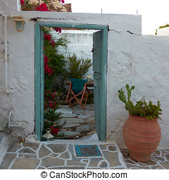 door and flower pot, Greece - door and flower pot, Milos...