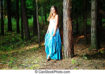 pinery - Romantic young woman posing outdoor.