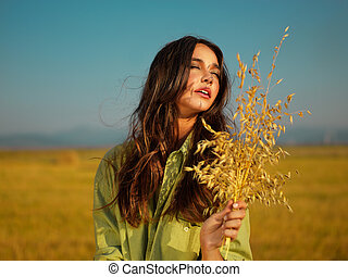young woman enjoying summer sunset in nature - beautiful...