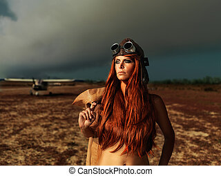fashionable aviator woman with smokey plane - fashion...