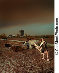 young woman vintage clothes posing cows windmill