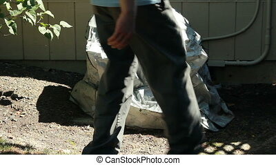 Man Removing Air Conditioner Cover - Male removing a gray...