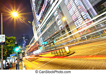 modern urban city at night with traffic