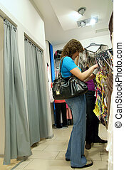 two women shopping clothes in shop
