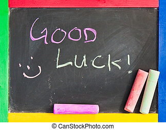Good luck written in chalk on a black board