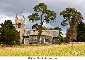 Rural Church - An old englis church on a hillside on a...