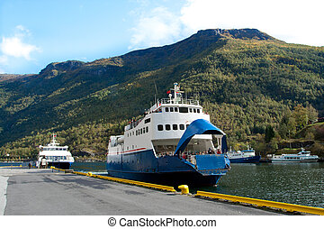 ferry boat on a berth at the norwegian fjord.