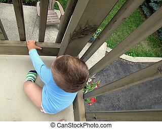 Baby on second floor balcony
