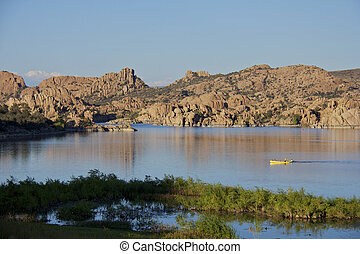 Watson lake, Prescott, Arizona - kayakers in a tranquil...