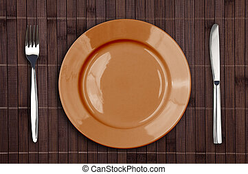 Bamboo placemat with plate fork and knife