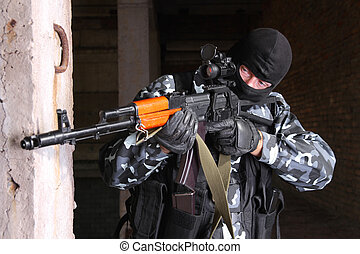 Sniper in black mask targeting - Photos of heavy equiped...