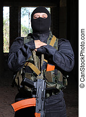 Soldier in black mask holding gun - Photos of heavy equiped...