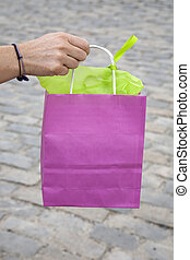 Pink Shopping Bag being Held by a Woman's Hand