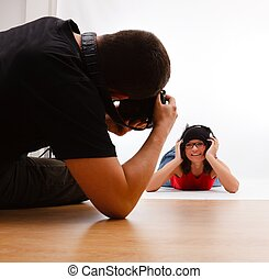 Photographer taking picture of woman laying on floor