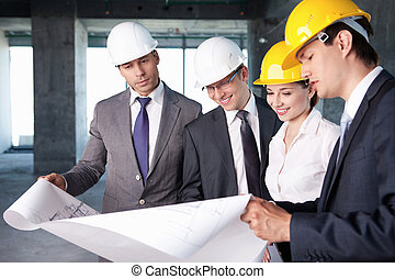 People at the construction site - Business people at a...