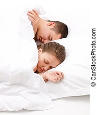 Man and women sleeping in bed