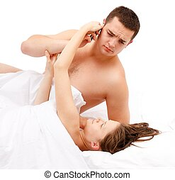 Laying woman taking phone from man