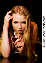 Young woman in a night bar - Thoughtful young woman lying on...