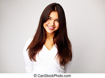 Lady - Image of young woman in white pullover smiling at...