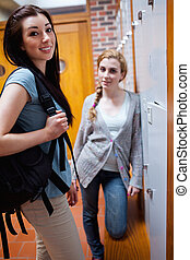 Young students standing up in a corridor