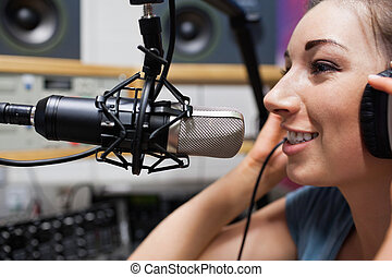 Close up of a young radio host speaking