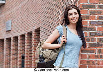 Student standing up outside a building