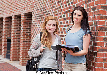 Students standing up outside a building