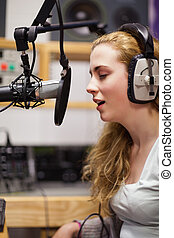 Portrait of a singer recording a track in a studio