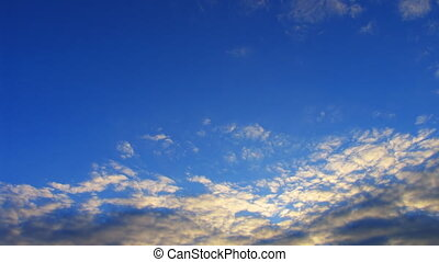 timelapse altocumulus clouds in evening sunset sky....