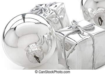 Christmas adornments - Present boxes and silver bulb on...