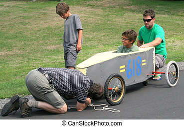 Readying the soapbox - Senior helping his grandsons get the...