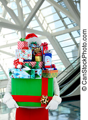 Woman with Christmas Presents in Mall