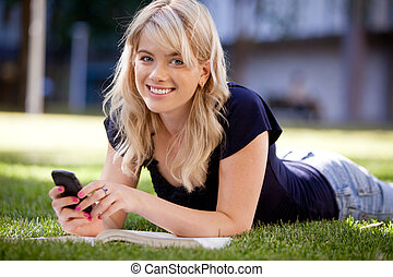 Female University Student Sending Text - Happy university...