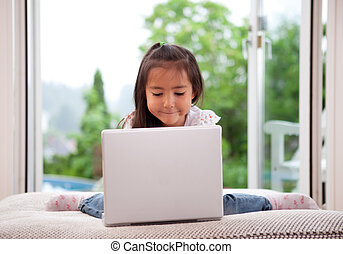 Cute Child Using Laptop Computer