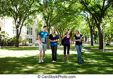 University Friends on Campus - Students walking through...