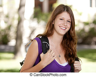Happy College Girl - Happy university student looking at the...