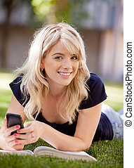 University Student with Cell Phone - Portrait of an...