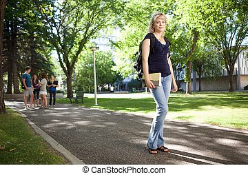 College Girl Walking to Class - Young blond college girl...