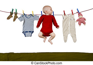 young child at clothes line - young child hanging at clothes...