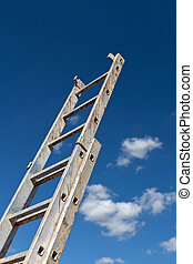 Dirty ladder pointing to the sky and some clouds