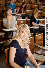Happy Young Student - Pretty blond student in lecture...
