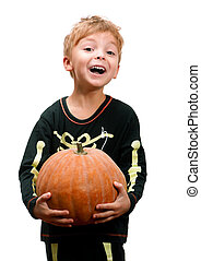 Halloween - Portrait of boy with pumpkin dressed of skeleton...