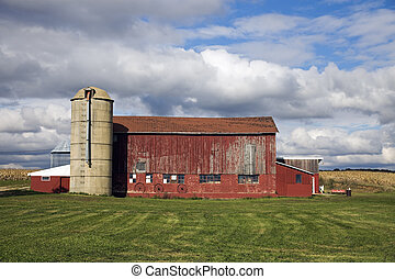 Colorful Midwest scene - red barn under cloudy sky
