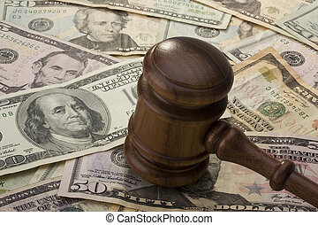 Gavel and Money - Law gavel laying on various denominations...