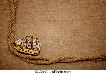 rope and model classic boat on canvas of burlap
