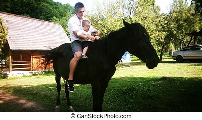 Adorable Baby Boy and Father Horse