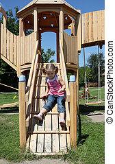 little girl fun on wooden playgroun