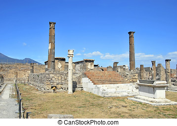 Temple of Apollo in Pompeii with an altar and a sundial....