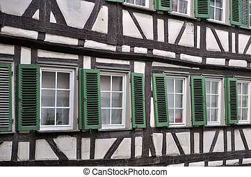 green shutters on wattle facade, tu - detail of misaligned...