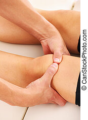 Therapeutic massage - A picture of a physio therapist giving...